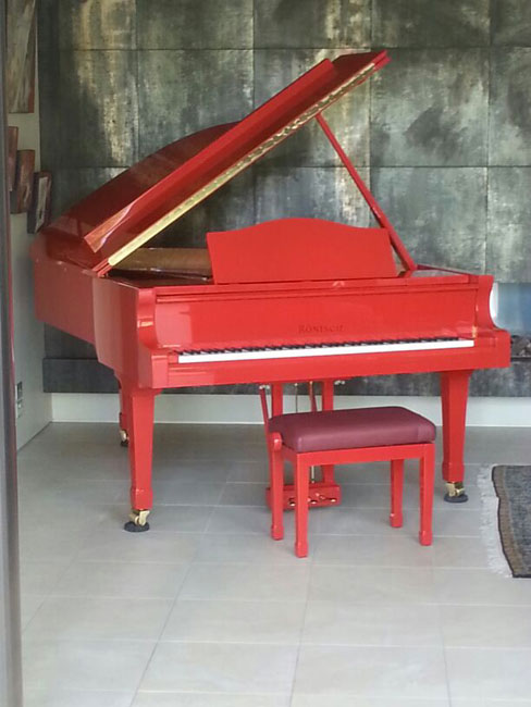 red piano moving in auckland