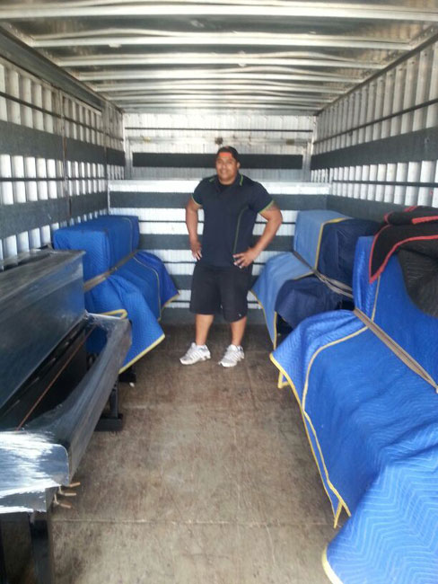 Piano movers in auckland moving four pianos in the truck safely
