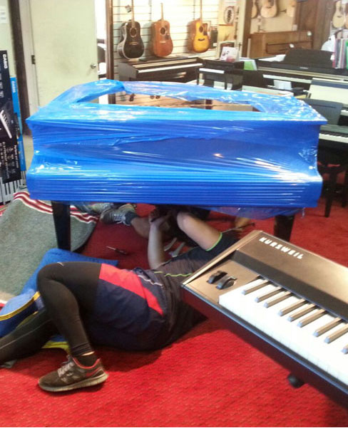 Uninstalling and wrapping the piano to move in Auckland