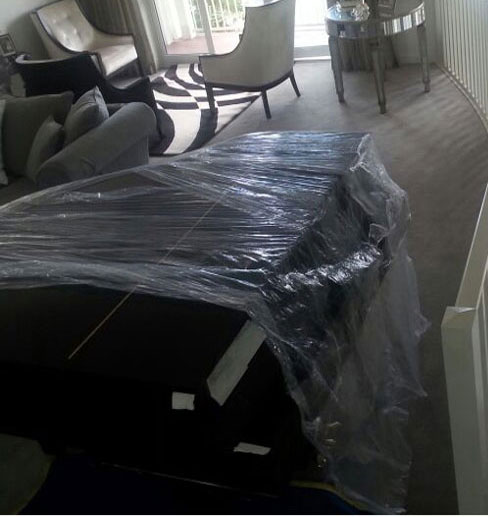 Wrapping and moving a piano in Auckland