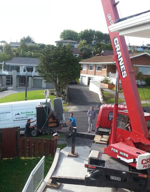 huge spa pool move in auckland by a crane